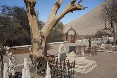 Cemetery in the Atacama Desert, Chile. Historic British Cemetery from the era of nitrate mining in the Atacama Desert, in the grounds of Hacienda Tiliviche in Stock Photography