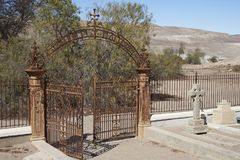 Cemetery in the Atacama Desert, Chile. Historic British Cemetery from the era of nitrate mining in the Atacama Desert, in the grounds of Hacienda Tiliviche in Stock Photo