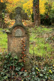 Cemetery in autumn. Tomb in a cemetery in autumn Stock Photography