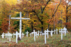 Cemetery in autumn forest Stock Photo