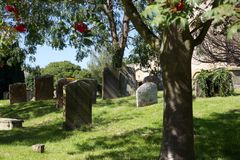 Cemetery, Bampton Village, England. The cemetery at St. Mary's Church in Bampton Village, England. The picturesque village is often used in filming and perhaps Royalty Free Stock Photography
