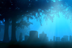 Cemetery in blue fog. Cemetery stones in surreal blue fog morning light Stock Photo