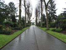 Cemetery chapel. A straight road which feeds directly to the cemetery chapel Royalty Free Stock Photography