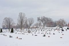 Cemetery covered in snow in Gatineau, Quebec. Cemetery covered in big layer of snow on a cold grey winter day in Gatineau, Quebec, Canada stock image