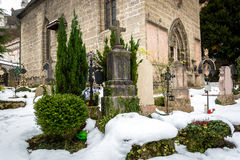 Cemetery covered by snow at old churchyard Royalty Free Stock Photo