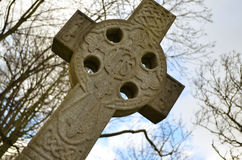 Cemetery Cross. A canted angle of a cemetery cross Stock Photo