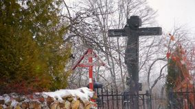 Cemetery cross covered by snow in winter season stock video footage