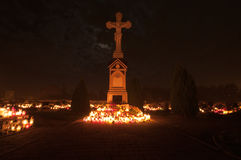 Cemetery - cross lit by candle lights Royalty Free Stock Photography