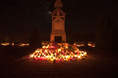 Cemetery - cross lit by candle lights Royalty Free Stock Images