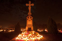 Cemetery - cross lit by candle lights Stock Images
