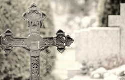 Cemetery. With cross and spiderweb in the foreground Stock Image