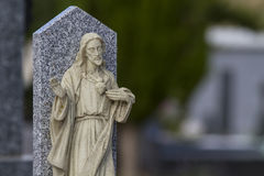 Cemetery detail with stone sculpture Stock Images
