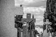 Cemetery, details of crosses and tombs with sculptures of jesus Royalty Free Stock Image