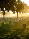Cemetery in the Fog. National cemetery in the fog on a bright morning Royalty Free Stock Photo