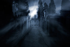 Cemetery in a foggy full moon night Royalty Free Stock Image