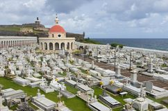 Cemetery and Fortress in Old San Juan. San Juan, PUERTO RICO - August 4, 2018: Santa Maria Magdalena de Pazzis cemetery and El Morro fortress in Old San Juan royalty free stock images