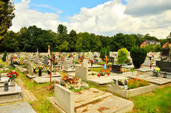 The cemetery full of flowers on a sunny day Stock Photo