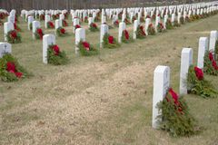 A cemetery full of veterans being remembered with a wreath. stock photo