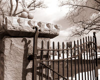 Cemetery Gates. This is a sepia tone of an old iron gate at a cemetery stock photos