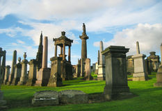 Cemetery in Glasgow, Scotland. Glasgow necropolis in late summer evening Royalty Free Stock Photography