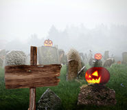 Cemetery with glowing pumpkins Stock Photography