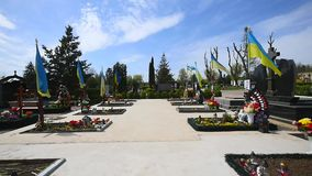 Cemetery.Graves of Ukrainan army and nationalist formations soldiers died during Ukrainian Civil War 2014-16 at Donbas stock footage