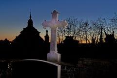 Cemetery graveyard tombstone cross  night, Leuven, Belgium. Cemetery graveyard with a light painted cross and lightpainted head stone at night, Leuven, Belgium royalty free stock photo