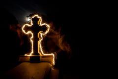 Cemetery graveyard tombstone sparkler night Royalty Free Stock Photos