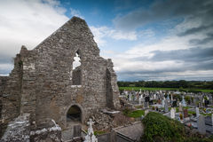 Cemetery grounds and old church ruins. Cemetery on the grounds of old church ruins in rural Ireland royalty free stock images
