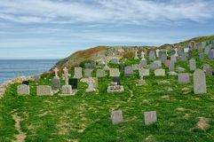 Cemetery with headstones overlooking the ocean. stock photos