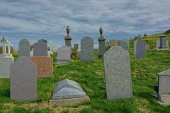 Cemetery with headstones on hillside royalty free stock photography