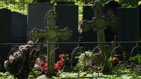 Iron crosses on graves stock video