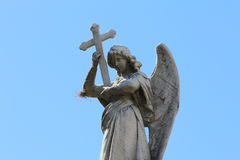 Cemetery La Recoleta. The image shows the outside of a private mausoleum rooftop. Angel holding a cross Royalty Free Stock Images