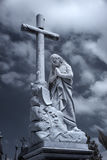 Cemetery lady and cross statue Royalty Free Stock Photos