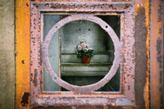 Cemetery mausoleum with flowers and window Stock Images