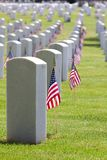 Cemetery Memorial Day. United States American Flags decorate the gravestones of veterans at a USA national cemetery on Memorial Day Stock Photo