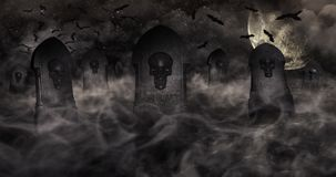 Cemetery At Night With Tombstones With Skulls And Cloudy Sky Ful Royalty Free Stock Photos