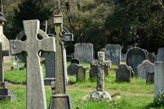 The Rich & poor. Headstones in church cemetery stock photos