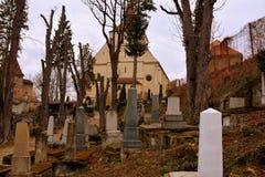 Cemetery. Old medieval saxon lutheran church in Sighisoara, Transylvania, Romania stock photos