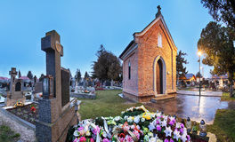 Cemetery panorama at night with chapel and flowers Royalty Free Stock Photo