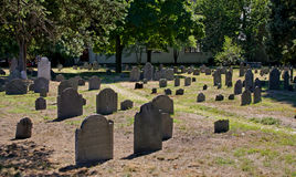 Cemetery path. Grave yard image showing old slate tombstonesand walking path in cambridge massachusetts Royalty Free Stock Images