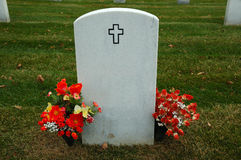 Cemetery Plot. A christian cemetery gravestone with flowers stock photos