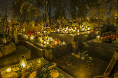 Cemetery in Poland on All Saints Day. Illuminated with candles stock images