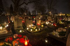 Cemetery in Poland on All Saints Day. Illuminated with candles stock image