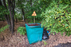 Cemetery in Pripyat. Radiation sign on a graveyard in abandoned Pripyat city in Chernobyl Exclusion Zone, Ukraine Royalty Free Stock Photo