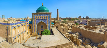 The cemetery quarter. The aerial view of Mausoleum of Pahlavon Mahmud, surrounded by large medieval cemetery, Khiva, Uzbekistan Stock Photos
