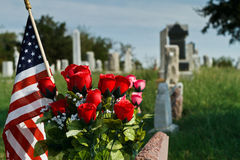 Cemetery with roses and American Flag Royalty Free Stock Photo