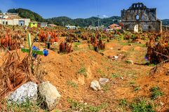 Cemetery & ruined church, San Juan Chamula, Mexico. San Juan Chamula, Mexico - March 25, 2015: Ruined church & cemetery in San Juan Chamula, an indigenous town royalty free stock photography