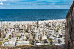 Cemetery in San Juan Puerto Rico. View from the wall above with ocean in the background stock image
