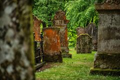 Cemetery, scotland historical gravestones with plant. Tips for travel, photography in summer Royalty Free Stock Photo
